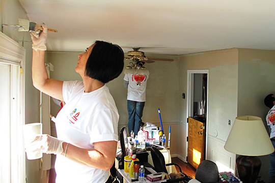 volunteers painting house