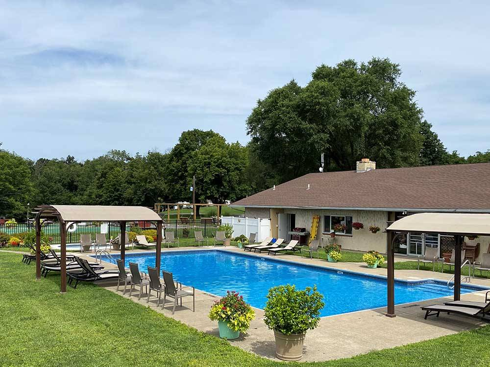 Tennis court lodge and outdoor pools at TRIPLEBROOK CAMPING RESORT