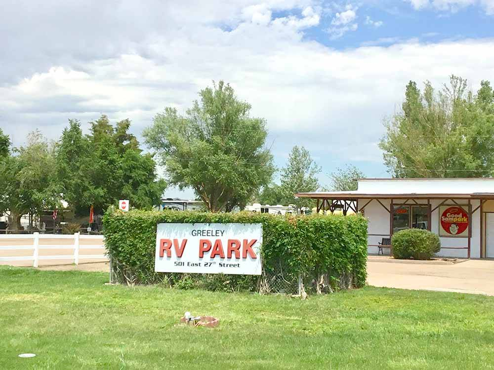 The front entrance sign and building at GREELEY RV PARK