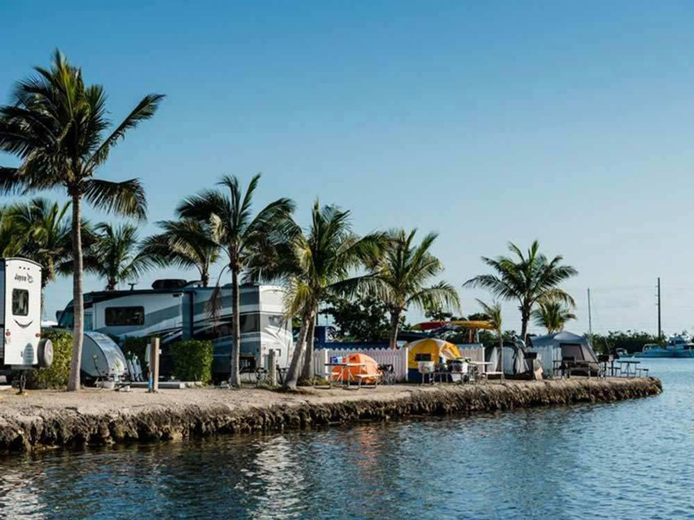 Trailers and tents up against the water at BOYDS KEY WEST CAMPGROUND