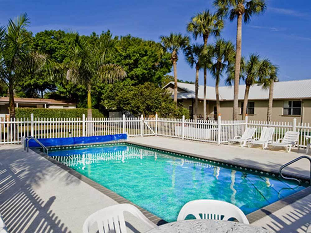 Swimming pool with outdoor seating at ORANGE GROVE RV RESORT