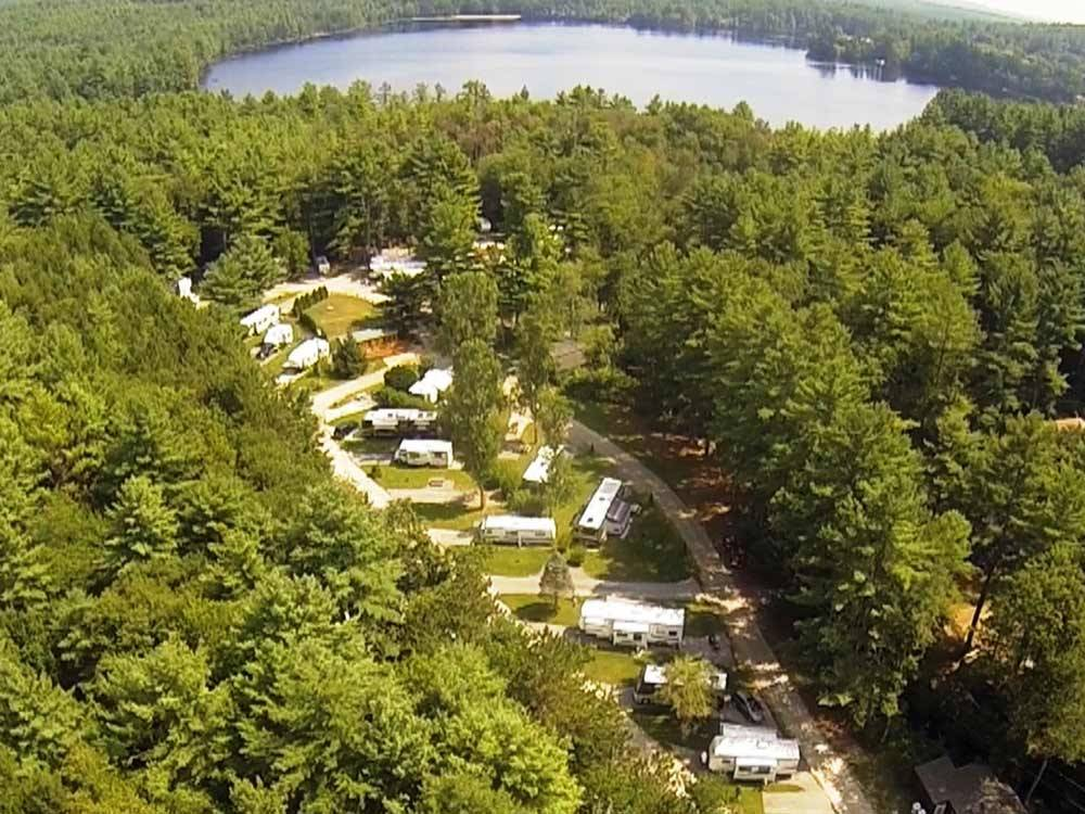 RVs and truck and trailers camping on the lake at FIELD  STREAM RV PARK