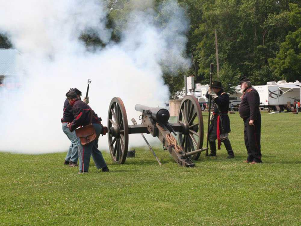 Men firing a cannon at the battlefield at GETTYSBURG CAMPGROUND