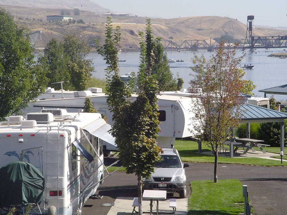 RVs and trailers camping on the river at GRANITE LAKE PREMIER RV RESORT