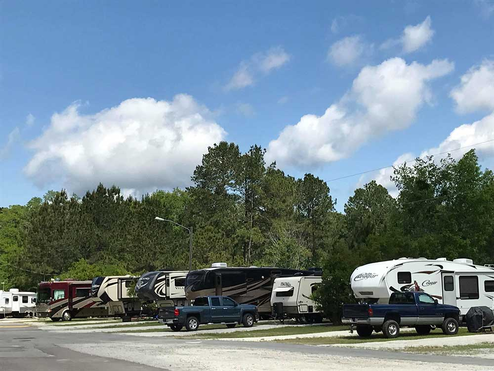 RVs and truck and trailers camping at WHISPERING PINES RV PARK