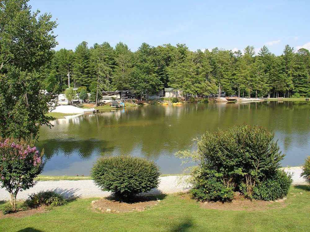 A view of the lake and RV sites at RUTLEDGE LAKE RV RESORT