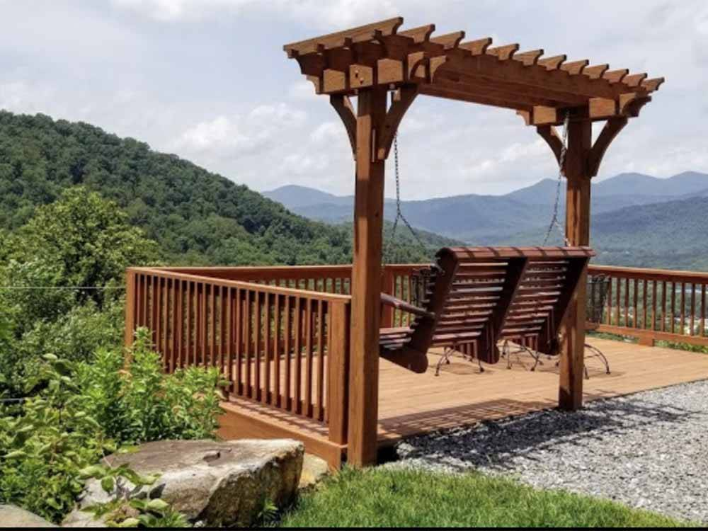 A swinging bench seat overlooking the valley at MAMA GERTIES HIDEAWAY CAMPGROUND