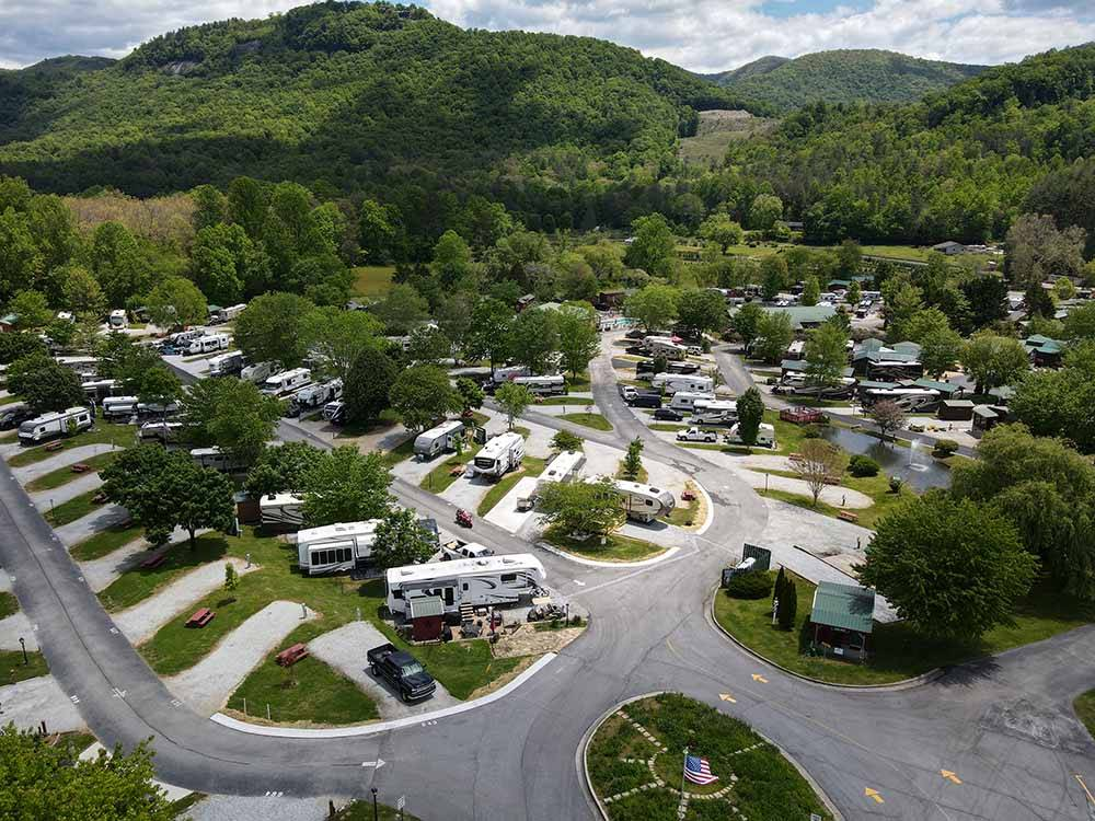 RVs parked in back-ins with background greenery at RIVER VISTA RV RESORT