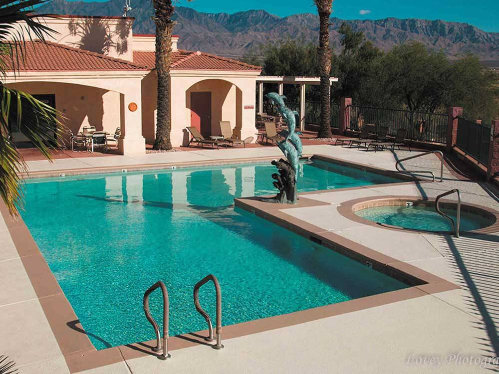 Swimming pool and spa at DESERT SKIES RV RESORT
