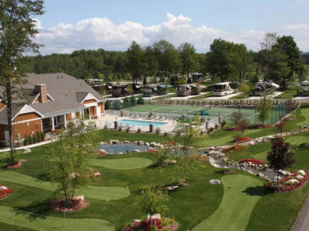Aerial view over small golf course pool and tennis court at PETOSKEY RV RESORT