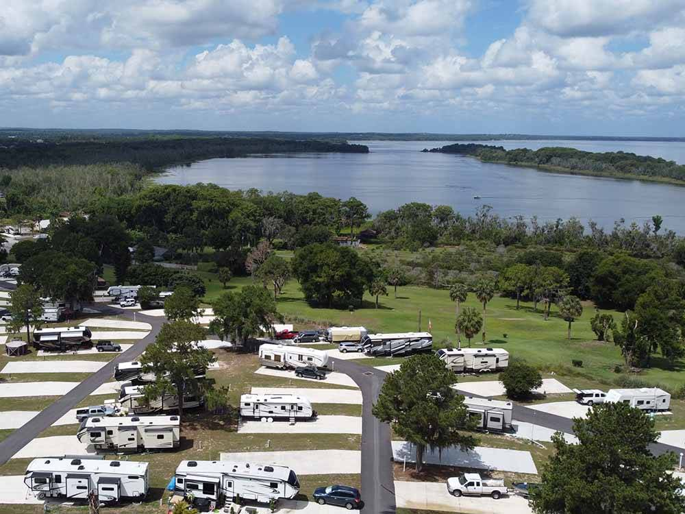 RVs and trailers at campground at FISHERMANS COVE GOLF  RV RESORT
