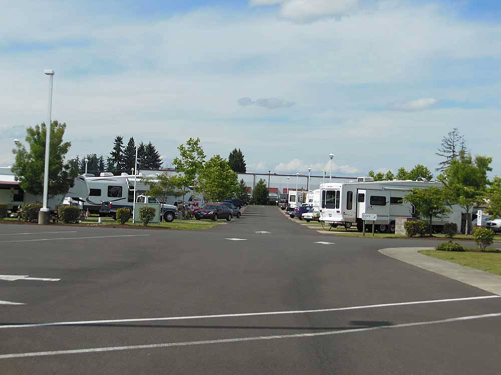 White RVs and trailers at campground parked at HEE HEE ILLAHEE RV RESORT
