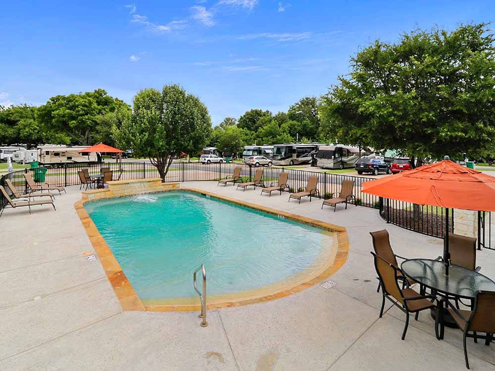 Swimming pool with outdoor seating at NORTHLAKE VILLAGE RV PARK