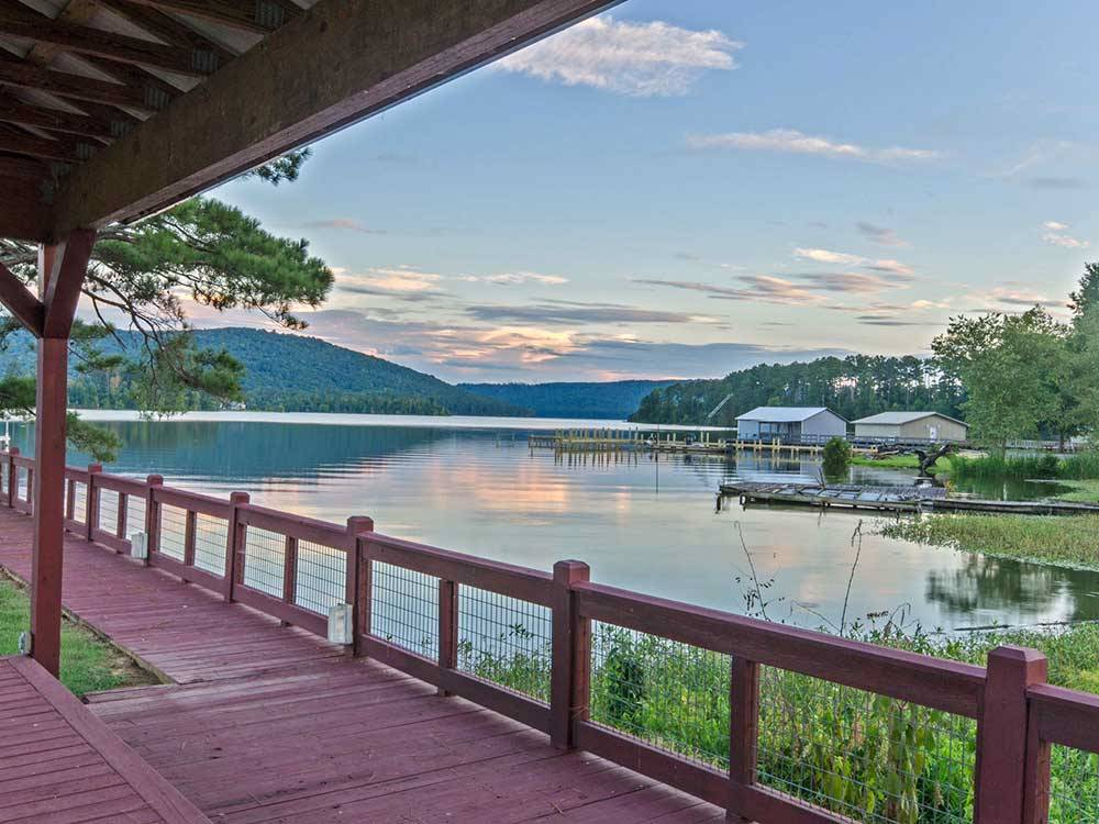 View of the lake with docks and boathouses at WINDEMERE COVE RV RESORT