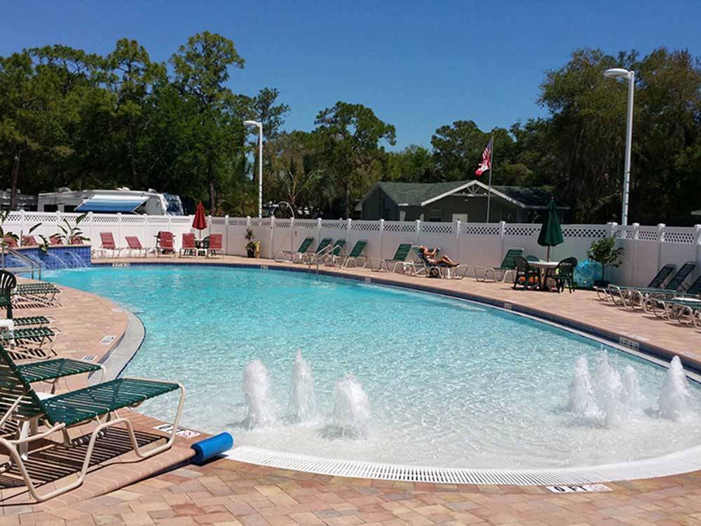 Swimming pool with outdoor seating at SEMINOLE CAMPGROUND