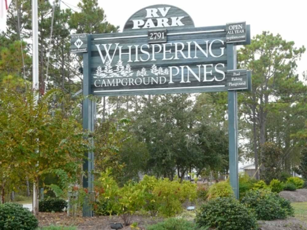 Sign of the park entrance at WHISPERING PINES RV PARK