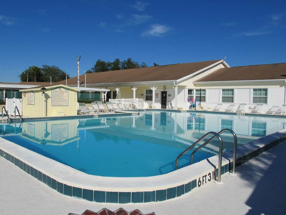 Swimming pool with outdoor seating at CRYSTAL LAKE VILLAGE
