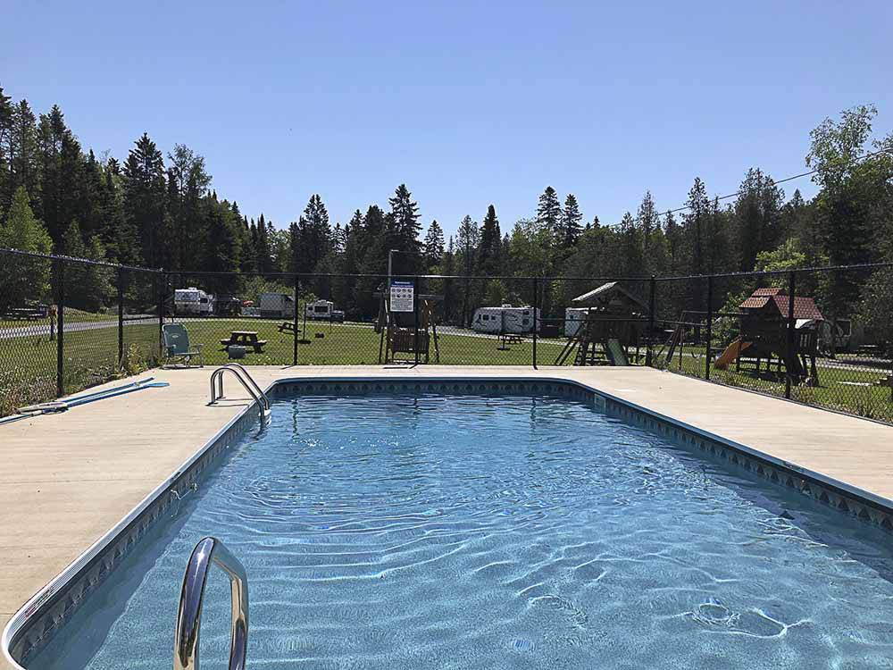 The pool with trees all around at RAPID BROOK CAMPING