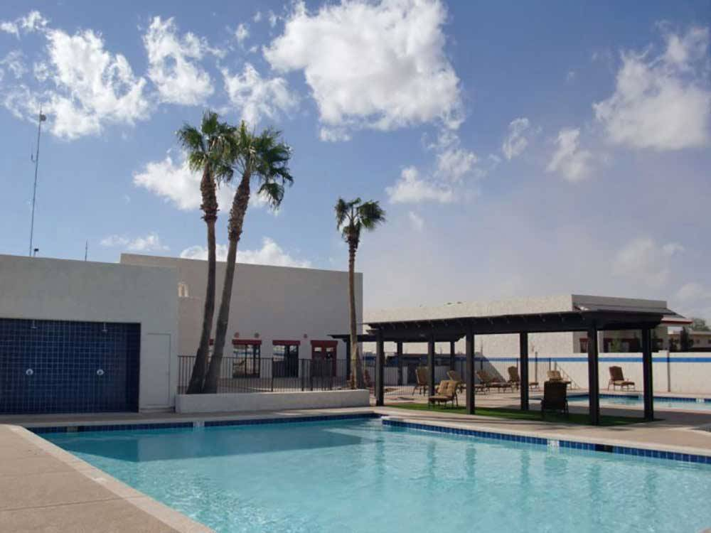 Swimming pools and patio cover at CASA GRANDE RV RESORT  COTTAGES