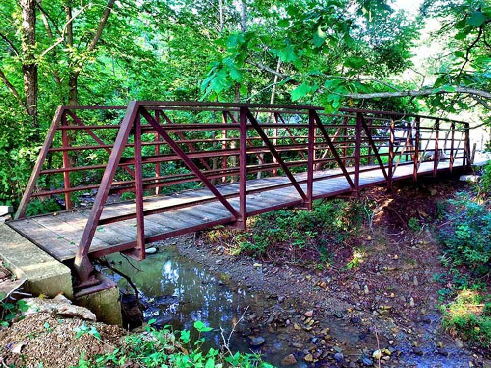 Bridge over stream at GLENWOOD RV RESORT