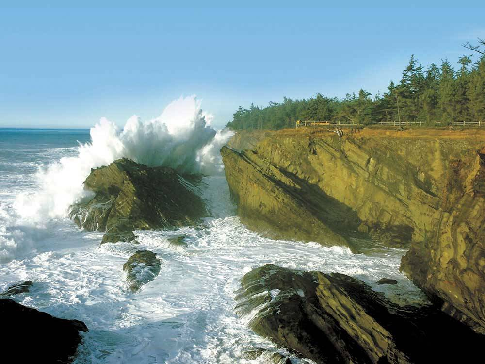Ocean waves crashing into rocks at OREGONS ADVENTURE COAST