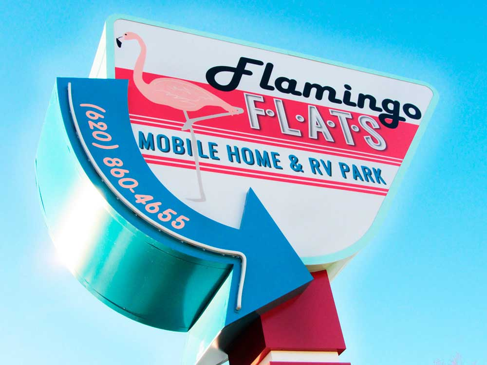 Sign at entrance to the park at FLAMINGO FLATS MOBILE HOME  RV PARK
