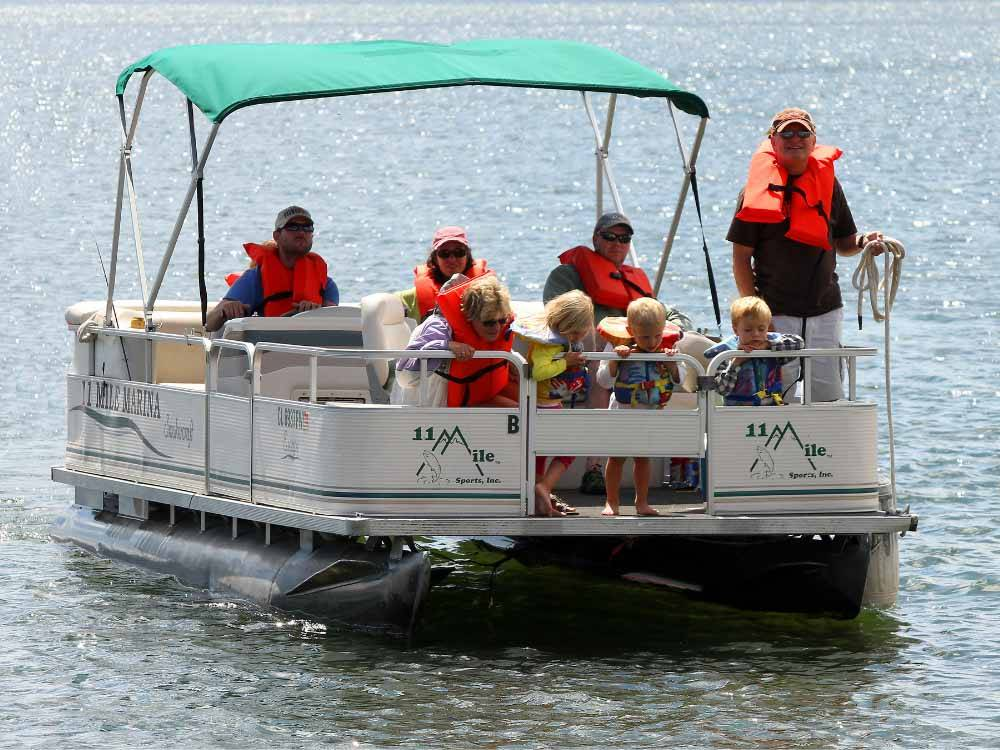 Men fishing on the lake at COLORADO PARKS  WILDLIFE