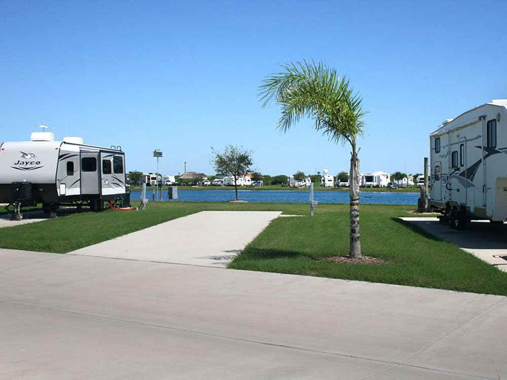 The back in paved RV sites by the water at TEXAS LAKESIDE RV RESORT