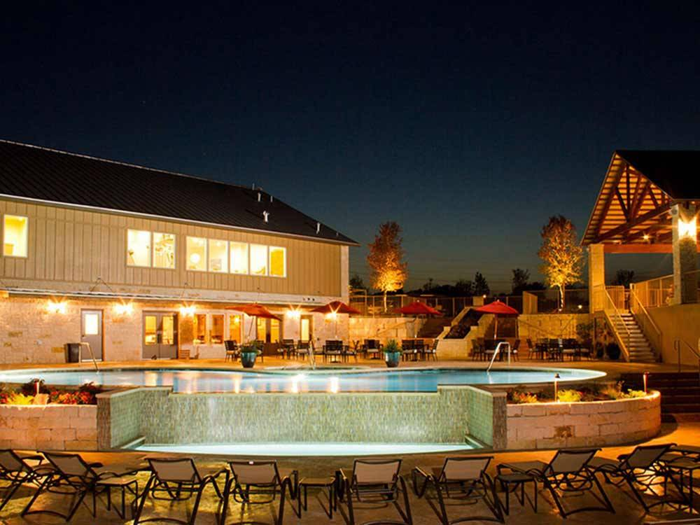 Swimming pool area at night at ALSATIAN RV RESORT  GOLF CLUB