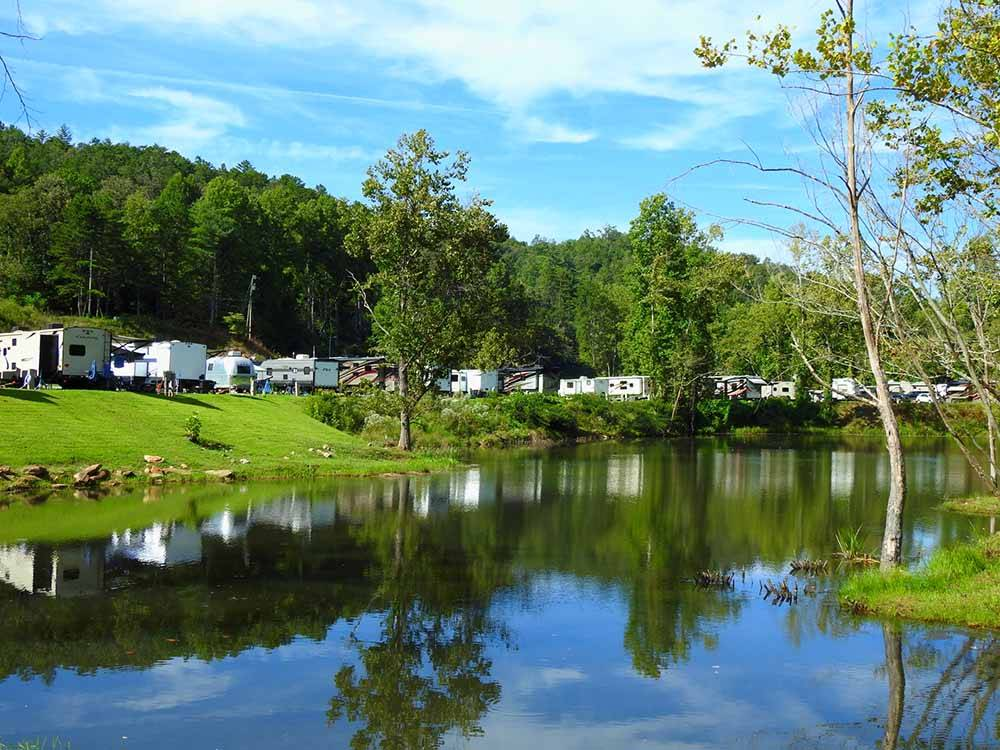The RV sites along the water at VALLEY RIVER RV RESORT