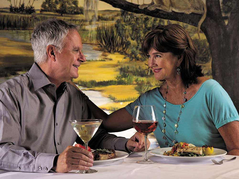 Couple having dinner at BRIGHTON RV RESORT