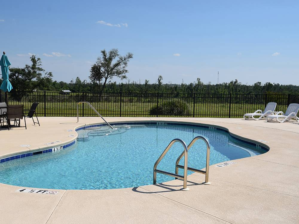 RVs and trailers at campground at ALLIANCE HILL RV RESORT