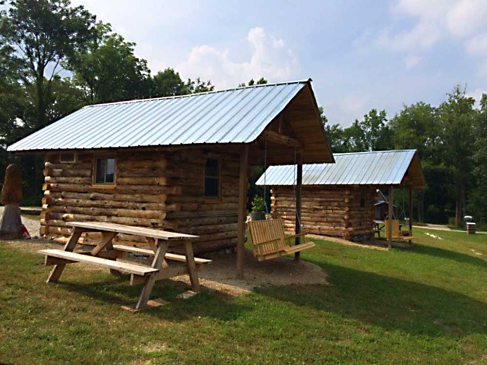 Log cabins at PEACEFUL WATERS CAMPGROUND AND CABINS