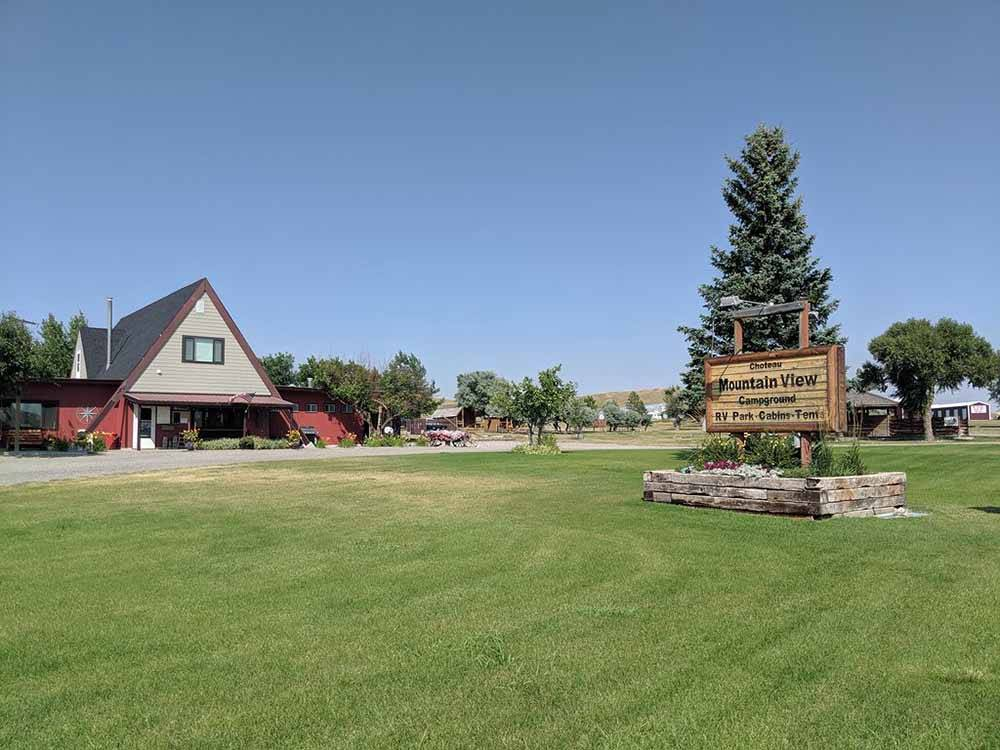 The front entrance sign and building at CHOTEAU MOUNTAIN VIEW CAMPGROUND