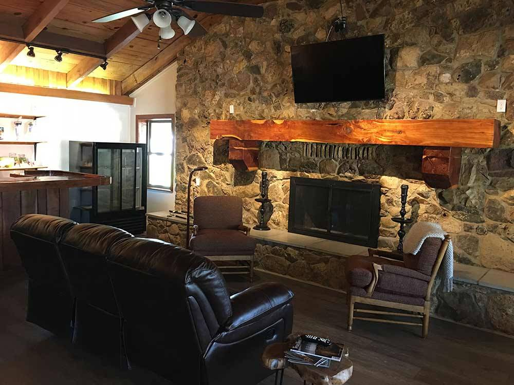 Fireplace inside lodge at TYLER OAKS RV RESORT