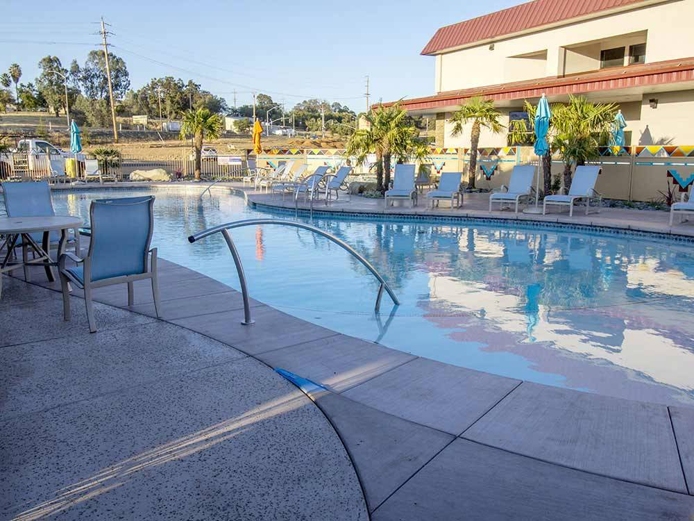 Swimming pool with outdoor seating at BERRY CREEK RANCHERIA RV PARK