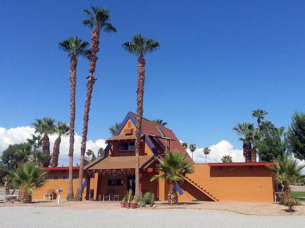 Lodge Office with palm trees at CATHEDRAL PALMS RV RESORT