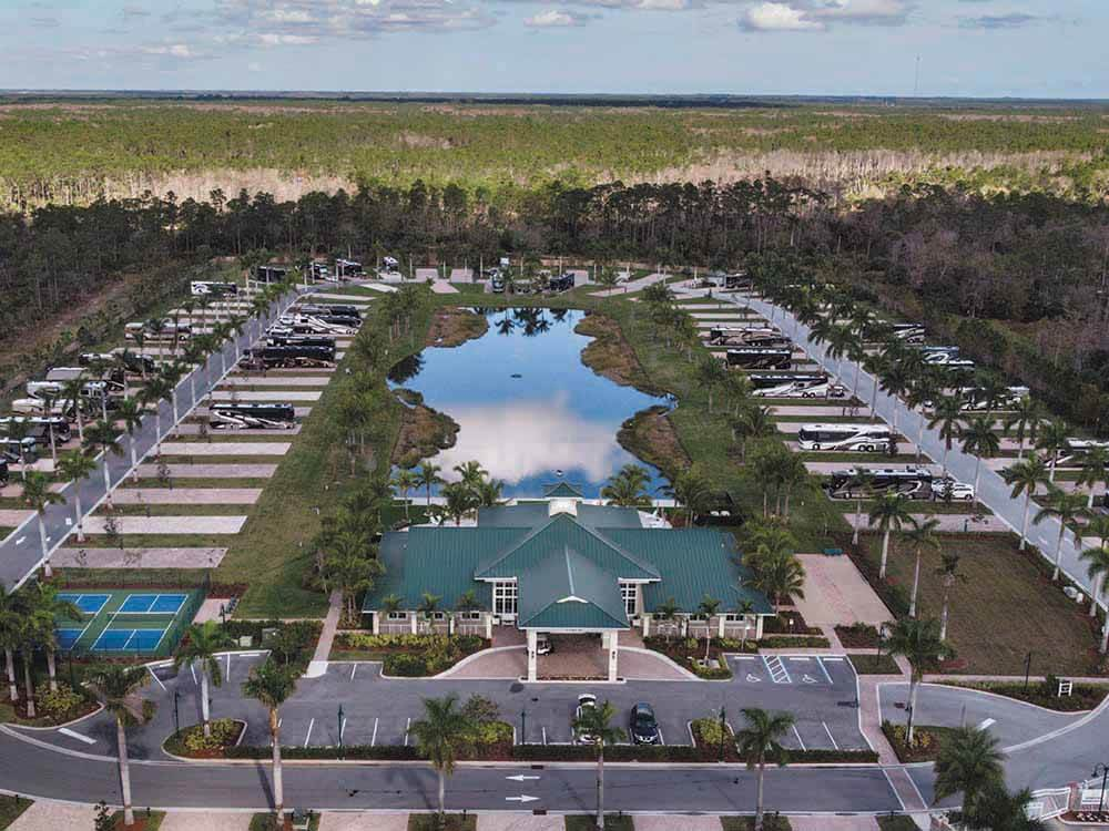 An aerial photo of the clubhouse lake and sites at PALM BEACH MOTORCOACH RESORT