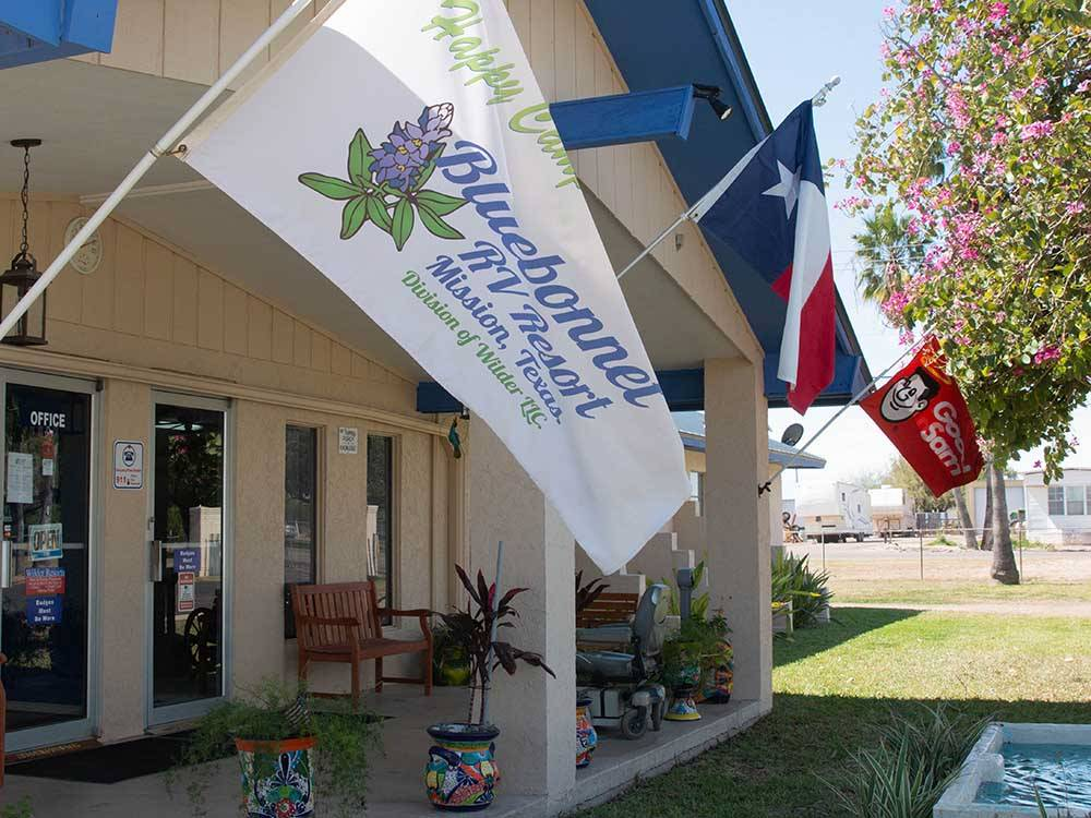 Flags on the front of the main building at BLUEBONNET RV RESORT