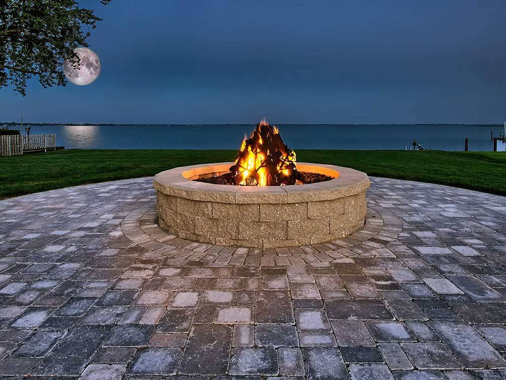 Fire pit with the moon over the lake at NORTHPOINTE SHORES RV RESORT