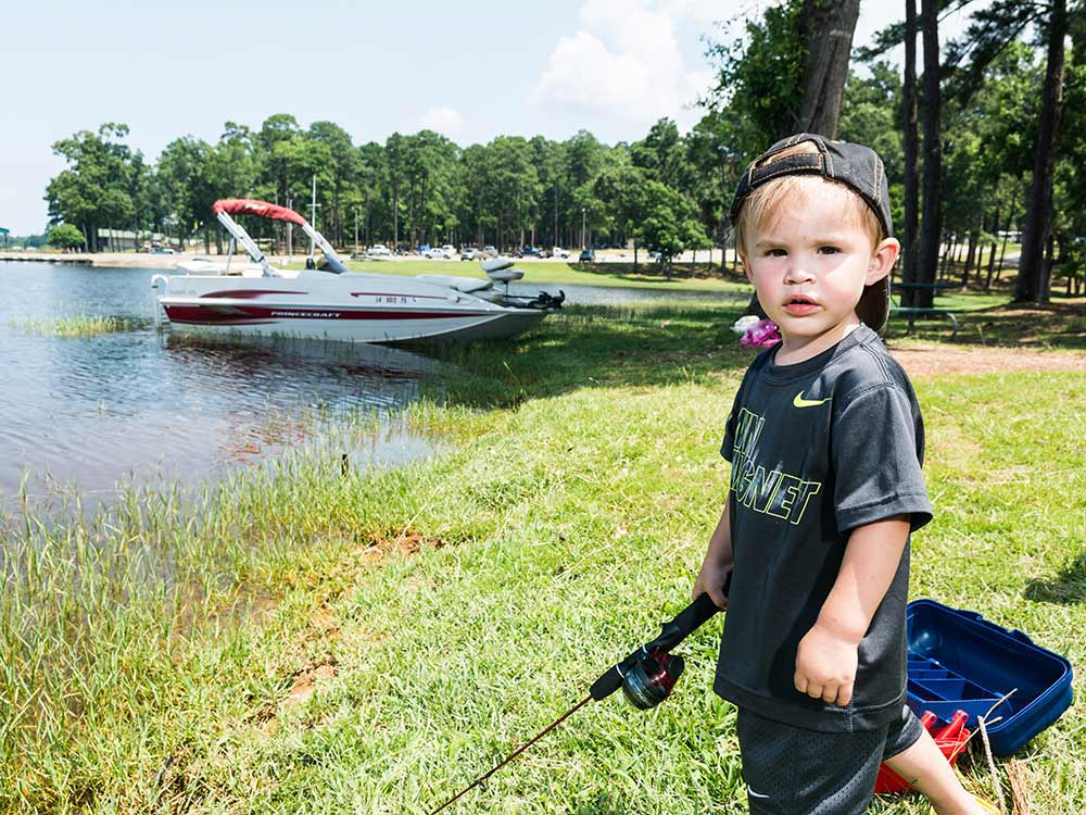 Boy fishing at TOLEDO BEND RV RESORT AND CABINS