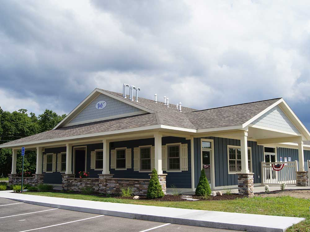 Exterior view of the park office at THE BLUFFS ON MANISTEE LAKE