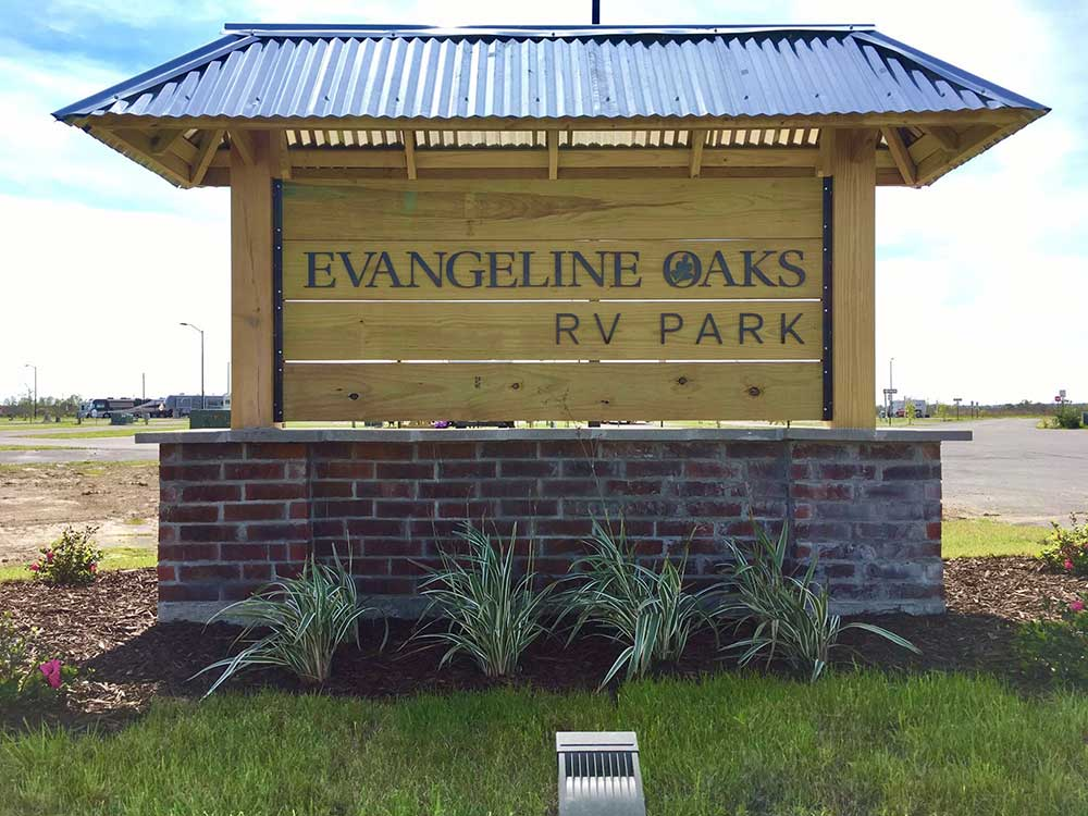 Sign at entrance of RV park at EVANGELINE OAKS RV PARK - IOWA