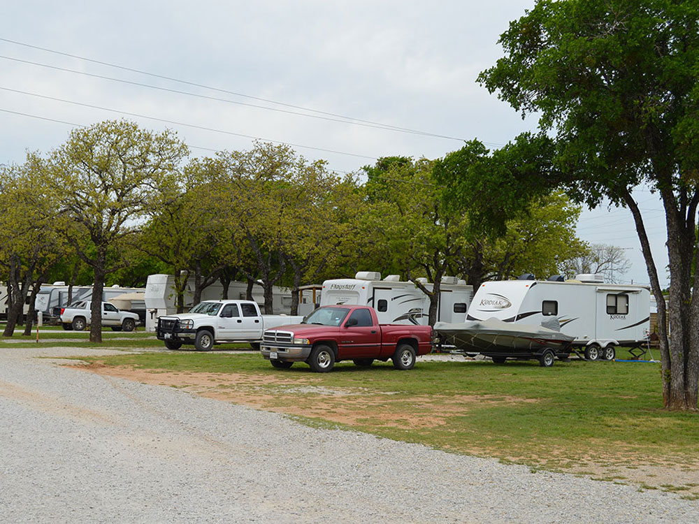 Trailers camping at campsite at LA MANCHA LAKE RESORT