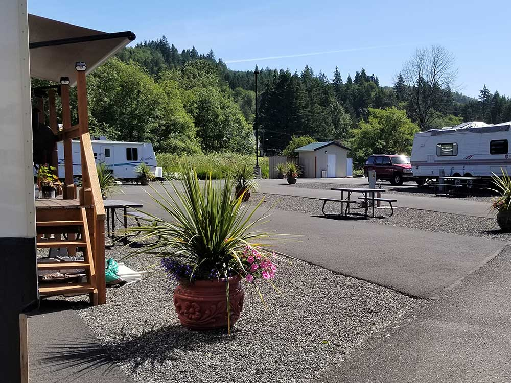 View of paved RV sites with picnic tables at CLATSKANIE RIVER INN  RV PARK