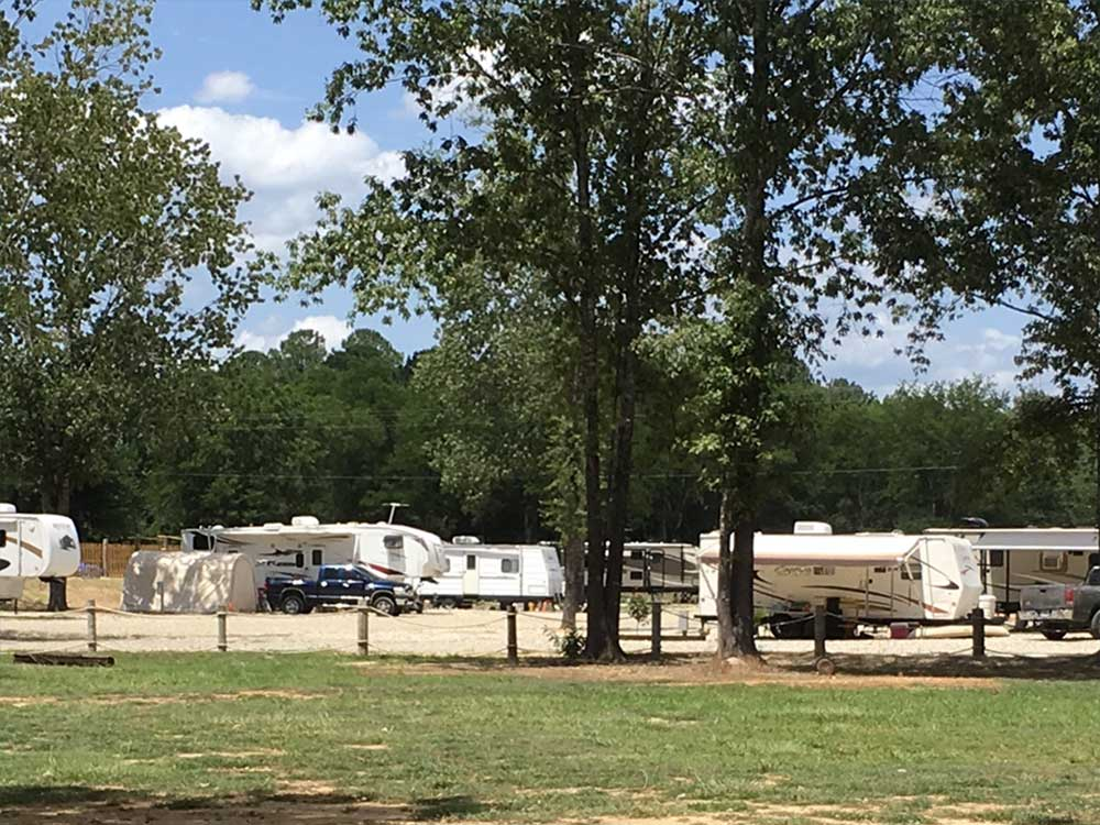 Trailers camping at campsite at GOLDENS RIVERSIDE RV PARK