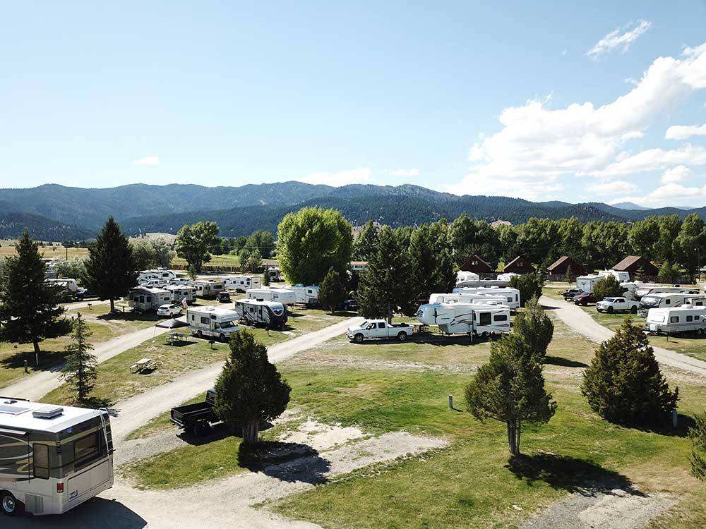 Drone view of park with distant mountains at FAIRMONT RV RESORT