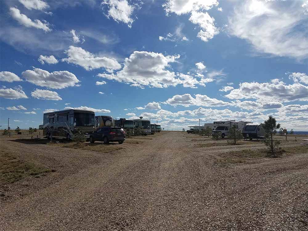 A row of gravel RV sites at CUERVO MOUNTAIN RV PARK AND HORSE HOTEL