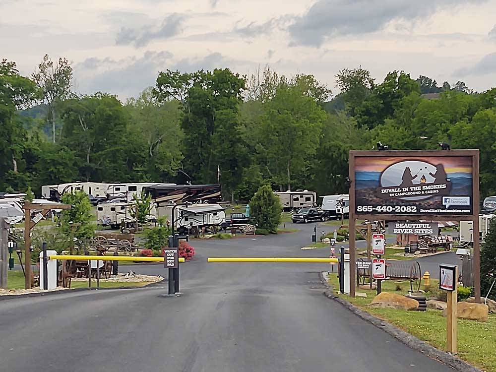 Overhead view of RVs parked in sites around office and play area with sandbox at DUVALL IN THE SMOKIES RV CAMPGROUND  CABINS