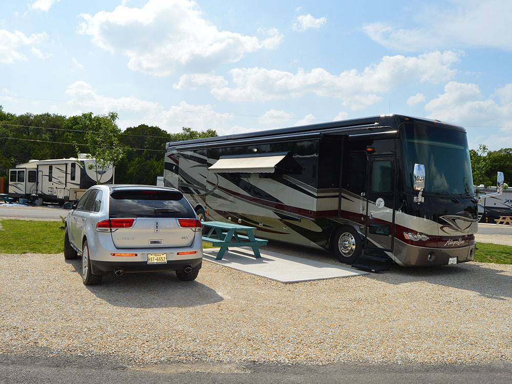 Front entrance patio of red and stone building at BASIN RV PARK